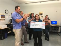 Walnutwood  teacher Jessica Cisneros-Elliott receives an award check for $1,000 as part of her recent recognition as ABC10's Teacher of the Month.  -- Photo courtesy FCUSD