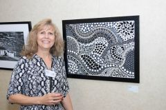 "Artist Robin Moyher with her mosaic titled Zentangle. Moyher uses her art to raise money for missions. ""While I am not called to go into the mission field,"" Moyher said on her Facebook page, Mosaics for Missions, ""I do feel called to help support those who do go."" 
