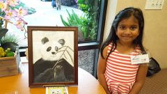 Six-year-old Shakthi Kondakindi is also featured at the art show with her picture of a panda drawn in oil pastels, hard pastels, and colored pencil. Shakthi said she worked from a copy of a National Geographic cover, and it took her about four days to finish the piece. 