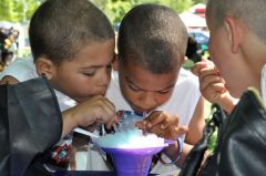 Icy deliciousness or brain freeze? These guys are finding out and having fun.  -- Photo by Rick Sloan