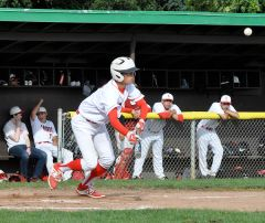 Putting the ball into play on a bunt is Cordova's Trevor Ready. Photo by Rick Sloan