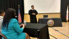 Public Defender Paula Spano looks on as Sacramento Superior Court Judge Hon. Russell Hom addresses students at Del Campo High School during a DUI Court in Schools Program April 28.