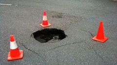 One of 9,000 potholes in Sacramento County. No cars or trucks were harmed in the photographing of this pothole. 