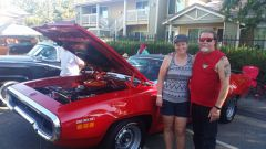 """Dennis Roediger and Carol Mortensen of Citrus Heights pose with their 1971 Plymouth Roadrunner. Roediger said they came for the car show and found out 'all the wonderful and different things in Citrus Heights.""""  -- Photo by Elise Spleiss"""