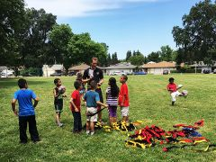 Nick Freitas collects forms from girls and boys from Williamson Elementary who are interested in signing up for the rugby program.