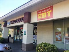 """What caught my eye was a large red, yellow and white sign that read, """"WE ACCEPT EBT."""""""
