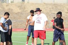 Cordova varsity football head coach Darren Nill goes over a blocking assignment with a frosh-soph football player in Monday's practice at Lancers Stadium. Photo by Mike Bush