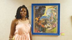 Artist Elizabeth Hall with her collage, The Romance of Summer. Photo by Margaret Snider