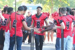 One of the returning Cordova football players, wide receiver/defensive back Calvin Augusta, No. 8 and center, is greeted by members of the Lancers' frosh-soph team at last Saturday's Meet the Lancers.