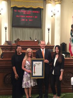Women's Empowerment executive director Lisa Culp, board member Nikky Mohanna and graduate Chantay White join Assemblymember Kevin McCarty to receive the California Nonprofit of the Year award. Photo courtesy Women's Empowerment