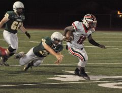 Cordova defensive back Raymond Fite (12) picks off a Rio Americano pass that was returned for a touchdown in the Lancers
