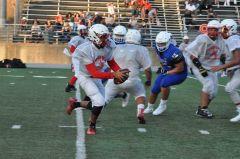 Cordova quarterback Tyreke Tate looks to find room to run against Capital Christian in last week