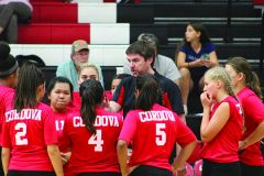 Cordova volleyball Mark Reuter (center) talks to his players during a timeout in a recent home match. Reuter and the Lady Lancers begin Sierra Valley Conference play next Thursday, Sept. 21st at home against rival Rosemont.