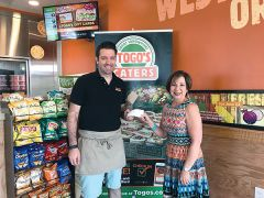 John Cornwell of Togo's of Carmichael  hands Linda Melody, Executive Director of the Carmichael Chamber a check for $500 to go help victims of Hurricane Harvey. Photo courtesy Carmichael Chamber of Commerce.