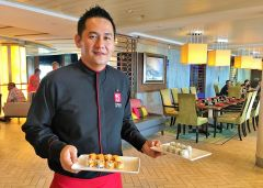 Jasper serves up Alaskan California and sunset rolls at Sushi on Five on the Celebrity Equinox. Photo by David Dickstein