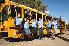 Volunteers celebrate as United Way collects school supplies for its Stuff the Bus campaign, one of dozens of projects that took place during United Way's 2017 Day of Caring in September. Photo courtesy United Way.