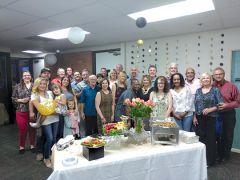 A full house of friends and clients attended the open house event to thank the BizCoach.com team for all their support. Photo by Paul Scholl