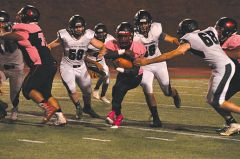 Cordova running back Jaylen Jones protects the football while running for yards in last week