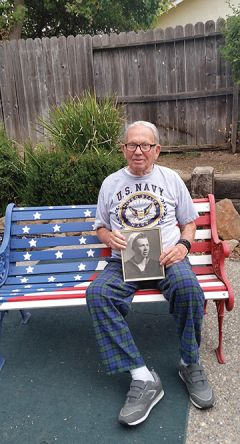 Okinawa survivor Bob Mellor proudly displays his Navy photo, his Navy uniform and the American Campaign, Asiatic Pacific Campaign and World War II medals he earned during his service in the Battle of Okinawa. Photo by Elise Spleiss