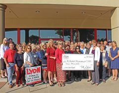 Local Lyon Real Estate agents and staff gather with staff from the Alzheimer's Association to offer the grant. Photo courtesy Lyon Real Estate