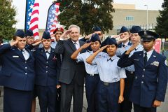 Senator Jim Nielsen joins a salute by Rancho Cordova High School ROTC Cadets. Photo by Susan Maxwell Skinner