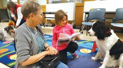 """Maddy said reading is fun, and she likes dogs, """"Because they're playful."""""""