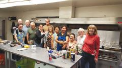 Volunteers are ready to prepare and serve at Holy Family Catholic Church Food Service for the Needy, hot dinner and food distribution held every Wednesday. Photo by Gary McFadyen