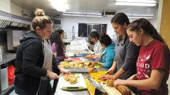 "Bella Vista High School students help slice bread for the needy at Holy Family Catholic Church in Citrus Heights.  In front are Bella Vista High School seniors Sydney Hart, 16 (left), Anna Lower, 17, and Sarah Dunham, 17.  ""I feel like I'm helping the community in a special way that not a lot of people realize,"" Sydney said.  Photo by Gary McFadyen"