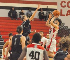 Cordova point guard shoots over a Vista del Lago player in the Lancers