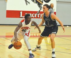 Cordova basketball players Caleb Clark (21) and LeAndre Ward (30) try to get the ball away from a Vista del Lago player in the Sac-Joaquin Section Foundation Game on Nov. 27th.