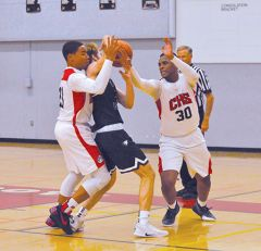 Cordova basketball players Caleb Clark (21) and LeAndre Ward (30) try to get the ball away from a Vista del Lago player in the Sac-Joaquin Section Foundation Game on Nov. 27th. Photo by Rick Sloan