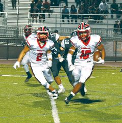 Cordova wide receiver Alvin Banks (16) finds room to run after a reception, with blocking from teammate Anthony Diaz in the Lancers