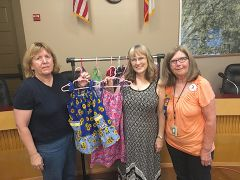 Pictured (R to L) Carol Pepper-Kittredge, Sharon Miranda and Debi Schneider show dresses being made by the Loomis Soroptimist International club and distributed by Dress a Girl Around the World. Photo courtesy of Karen Fraser-Middleton