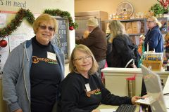 Pat Nelson (left) and Lisa Oakumura register clients at the front desk of the Orangevale Food Bank. Photo by Gary mcFadyen