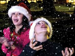 Jack Loverich (7) and sister Lucy (8) got a taste of white stuff generated last week by snow machines in Carmichael Park. Festivities included live music, a visit from Santa Claus and a count-down for Christmas light illumination. Picture by Susan Maxwell Skinner