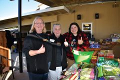 Volunteers Julie Walker-Howard, left, Ruth Ann Wright, and Veronica LoCurto staff the produce tables at the Orangevale Food Bank. Photo by Gary McFadyen
