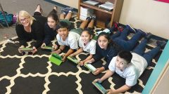 Principal Amy Hale, St. John Vianney, Rancho Cordova hangs out with a handful of 5th graders and their iPads in an after school enrichment session. Photo by Jacqueline Fox