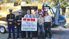 Posing in front of the 57-foot 1966 Vietnam era Huey are Marine Lance Corporal Reed, Toys for Tots Coordinator Corporal Campos, Congressman Ami Bera, and Boy Scouts Austin Eckard and Matthew Boster with Troop 635 leader Cathy Best. Photo by Elise Spleiss