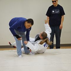 Ramona Herriford learns adaptive judo from 2012 London Paralympian Katie Davis at Society for the Blind's Paralympic Sport Event that wrapped up the group's participation in the National Fitness Challenge. Photo courtesy Society for the Blind