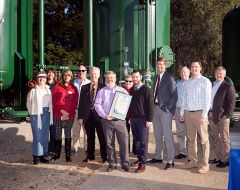 Cal Am engineering staff, including director of operations Audie Foster (holding Rancho Cordova proclamation)and  Chamber of Commerce staff,  City Councilmember Robert McGarvey and Sacramento County Supervisor Don Nottoli. Photo courtesy Cal American Water.