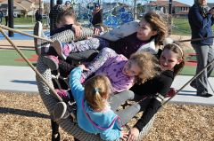 Kids in the community celebrate the opening of the new park. Photo by Rick Sloan