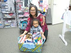 Ana Alvarado receives a baby basket from Sacramento Life Center, thanks to the group's Baby Basket Drive held each December. Photo courtesy Sacramento Life Center