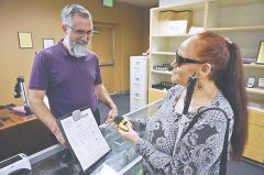 Shirley Garrett receives help from Cory Hanosh at the expanded onsite retail store at Society for the Blind in Sacramento. Photo courtesy of the Society for the Blind