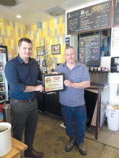 "Todd Colston, (at right) is congratulated by Rich Peters, Editor at MPG. Todd is the owner of Velocity Pizza, which won the awards for ""Best Restaurant,"" ""Best Pizza"" and ""Top Vote Getter."""