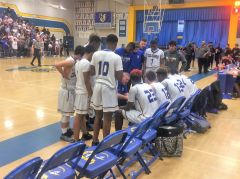 Del Campo coach Dave Nobis addresses his team late in the fourth quarter in what ended in a 71-65 victory over Cordova in the opening round of the Sac-Joaquin Division III Playoffs.