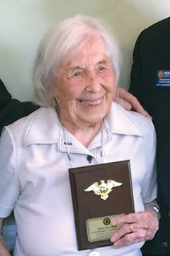 Lt. Balmer holds a plaque recognizing her as the oldest living female member of the American Legion at 108 years old. Photo courtesy of Brenda Sheriff