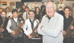 Presiding over the jazz festival named in his honor, Carmichael musician Wayne Reimers joins an ovation for Arden Middle School band members. Reimers taught at the school for 28 years. The sax player met fellow musician wife Barbara in an Idaho orchestra reed section.