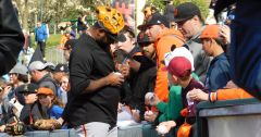 Giants third baseman Pablo Sandoval signs autographs for the diehard Giants fans who came out to the ballpark early. Photo by Barry Sibert