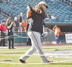 Giants shortstop Brandon Crawford takes a warmup swing during batting practice. Photo by Barry Sibert