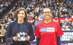 "Basketball fans applauded as Sacramento Kings' executive Joelle Terry presented Lisa Daniels with a ""Dream Award."""